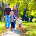 happy family on walk in park; Shutterstock ID 226916062; PO: ottobre